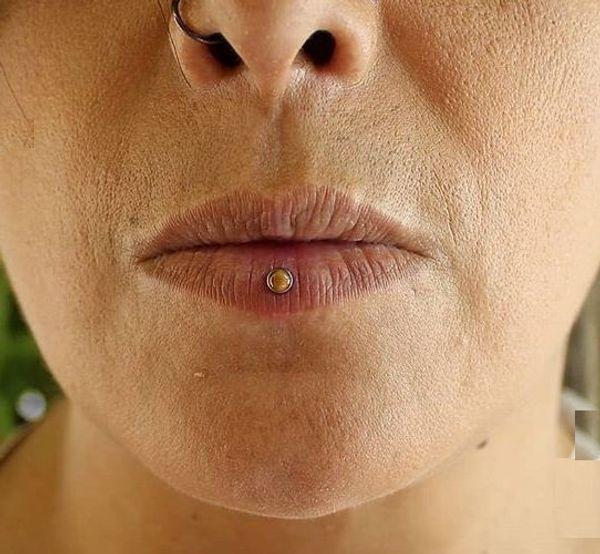 ashley piercing scar