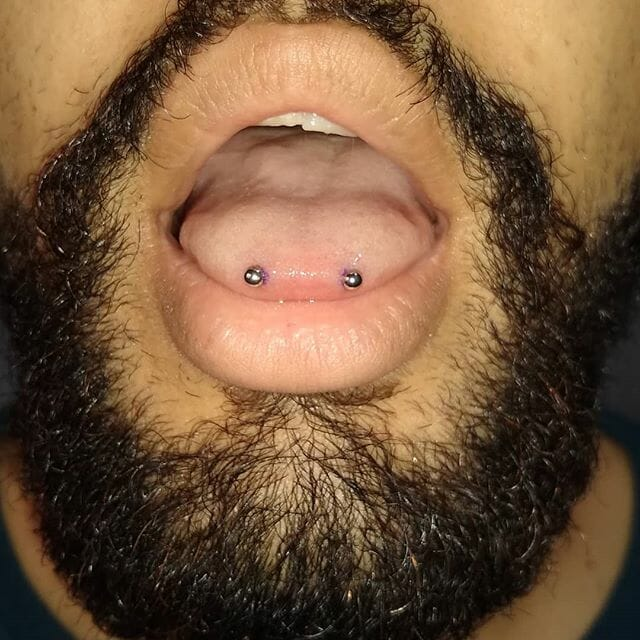 boys snake eyes piercing