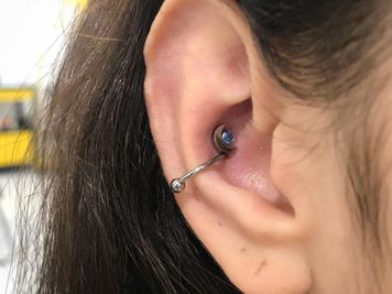 conch piercing moon