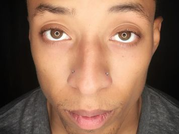 double nose piercing on men