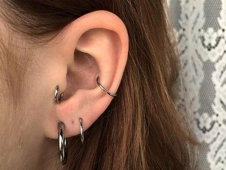 earlobe piercing cons