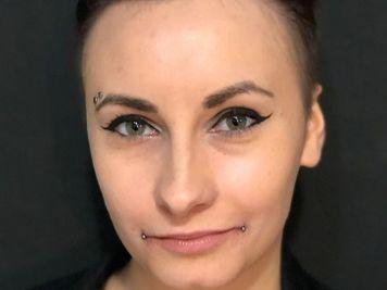 eyebrow and dahlia piercing