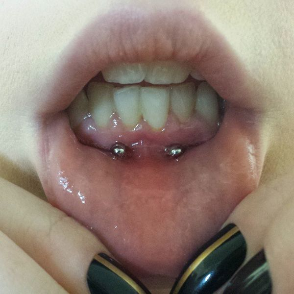 frowny smiley piercing