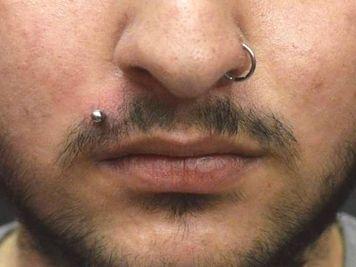 male madonna piercing