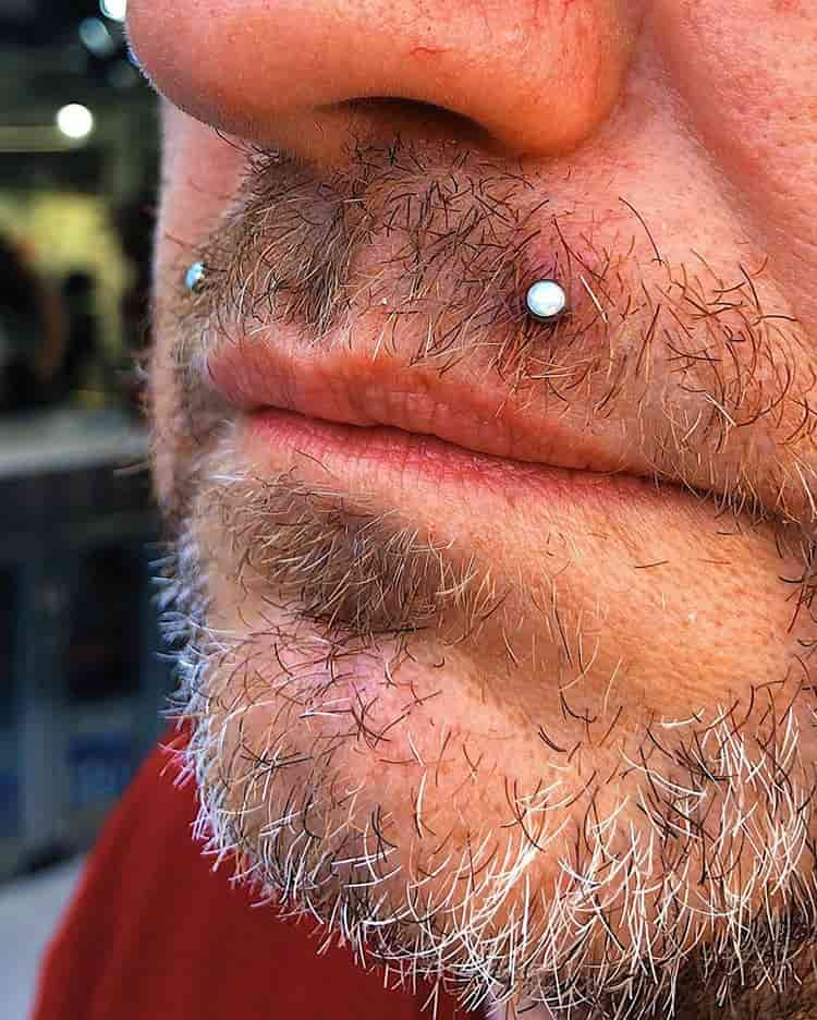 men angel bite piercing