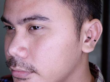 men snug piercing