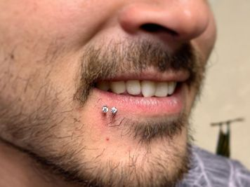 men spider bites piercing