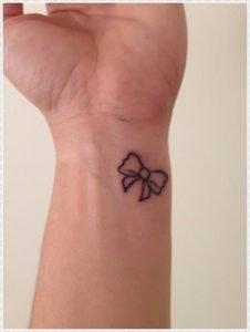 Note tattoo on wrist