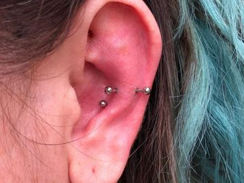 snug and conch piercing