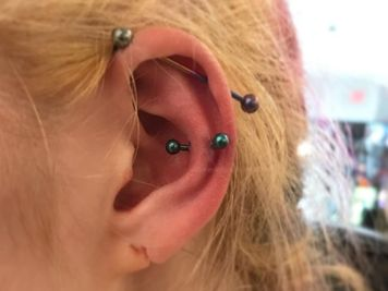snug and industrial piercing