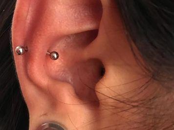snug ear piercing pic