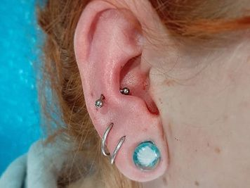 snug piercing images