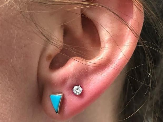 two earlobe piercings