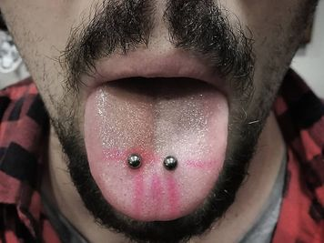 venom piercing on guys